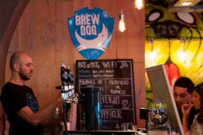 The bar and a bartender of Brewdog Roma