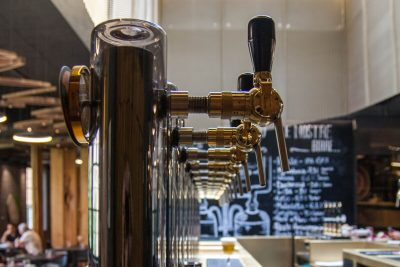 A view of a row of taps at L'Osteria di Birra del Borgo
