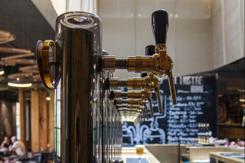 A view of a row of taps at L'Osteria di Birra del Borgo