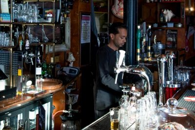 Nizam working behind the bar of Murphy's Law