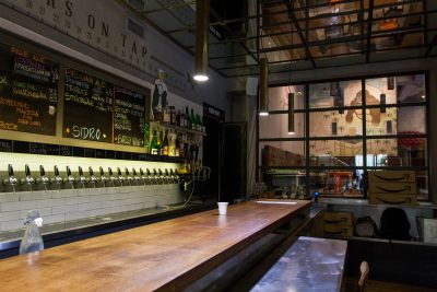 The bar and taps of Queen Makeda Grand Pub
