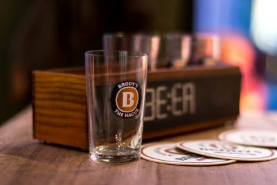 A small glass with a case for a beerflight at Brody's American Taphouse
