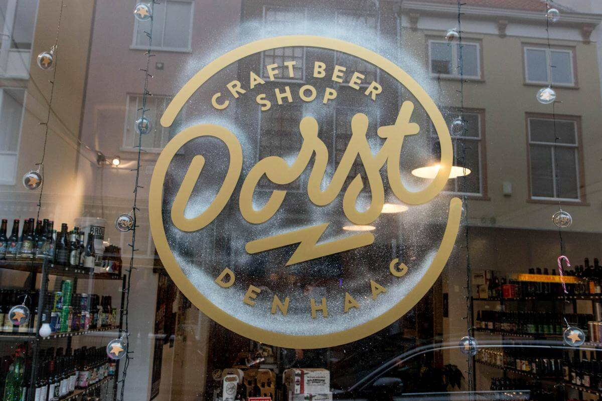 The logo on the window of Dorst Craft Beer Shop decorated for Christmas
