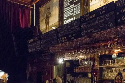 The bar and old details above it at Bierlokaal Locus Publicus in Rotterdam