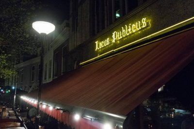 The illuminated letters on the building of Bierlokaal Locus Publicus in Rotterdam
