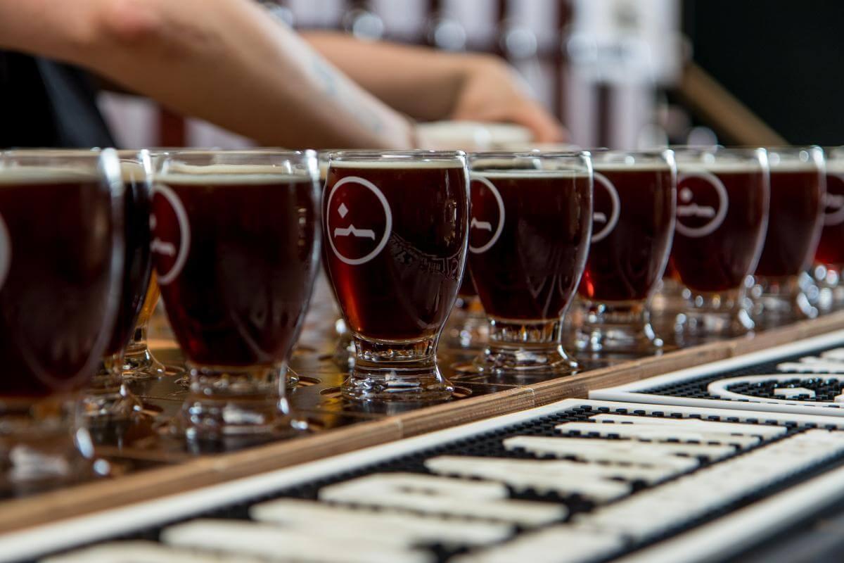 A nice row of beer flights at Kompaan Beer Bar