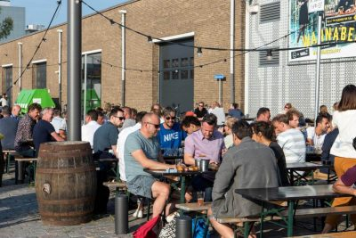 People enjoying their beer in the sun outside of Kompaan Beer Bar