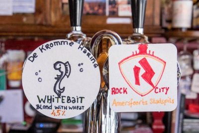 The cute way Café DeRat shows the beers on tap