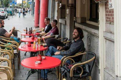 People enjoying their beer outside Proeflokaal De Riddert