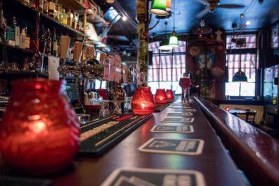 The long dark wooden bar at Proeflokaal De Riddert