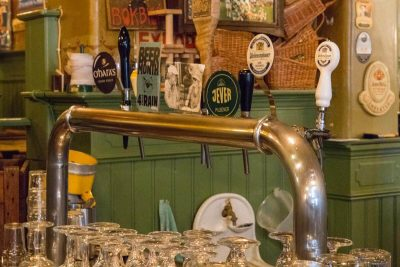 One of the arches with taps in the main room at Bierproeflokaal In de Wildeman