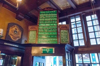 The menu above the entrance at Bierproeflokaal In de Wildeman